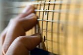 Hand on Electric Guitar Fretboard — Stock Photo