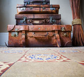 Stack of Old Leather Luggage on Tiled Floor — Stockfoto