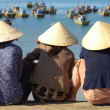 Women wait at Harbour - Stock Photo
