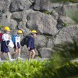 School Children Wearing Hard Hats, Sakura-jima, Japan - Stock Photo
