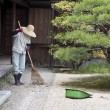 Gardener Raking Japanese Garden — Stock Photo