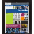 IPad Edition of the Guardian Newspaper - Stock Photo