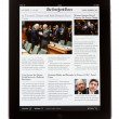 IPad Edition of The New York Times Newspaper - Stock Photo
