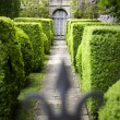 Doorway in a formal Garden - Stock Photo