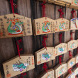 Wooden Prayer Tablets at Shinto Shrine - Stock Photo