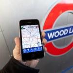 Using a London Underground App — Stock Photo #22529159