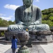 Woman Worships Great Buddha - Stock Photo