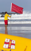 RNLI LIfeguard puts out Red Flag — Stock Photo