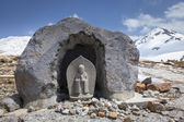 Stone Buddhist Statue in the Mountains — Stock Photo