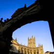 Bath Abbey framed by arch - Stock Photo