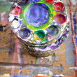 School Paint Mixing Trays Piled on a Board — Photo