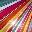 Stock Photo: Sun flare through coloured ribbons