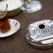 Ashtray and Tea — Stock Photo