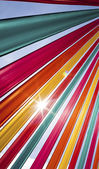 Sun flare through coloured ribbons — Stock Photo