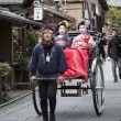 Stock Photo: Geishas in a Rickshaw