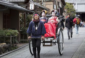 Geishas in a Rickshaw — Stock Photo