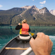 Canoeing on Emerald Lake - Stock Photo