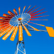 Orange Windmill Against a Blue Sky - Stock Photo