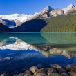 Stock Photo: Reflections in Lake Louise