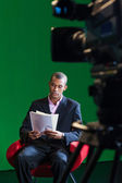 TV Presenter Reads Scripts — Stock Photo