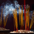 Stock Photo: Burning incense sticks