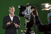 Presenter in studio with TV camera and Camera Operator — Stock Photo