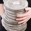 Holding Pile of Film Cans — Stock Photo