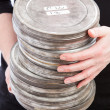 Stock Photo: Holding Pile of Film Cans