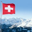 Stock Photo: Swiss Flag Flying Over Alpine Scenery