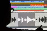 Man Editing Digital Audio on a Computer — Stock Photo