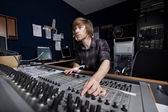 Man using a Sound Mixing Desk — Stockfoto