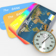 Stock Photo: Clock and bank cards