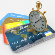 Clock and bank cards — Stockfoto