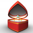 Red heart-shaped box with a gold ring — Stock Photo