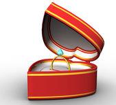 Röda hjärtformade låda med en guldring — Stockfoto