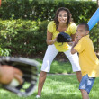 African American Family Playing Baseball - Stock Photo