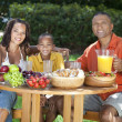 African American Family Eating Healthy Food Outside — Stock Photo #21588271