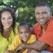 African American Family Mother Father Son Outside - Stock Photo