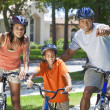 African American Parents WIth Boy Son Riding Bike — Stock Photo #21588323