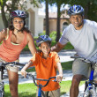 African American Parents WIth Boy Son Riding Bike — Stock Photo