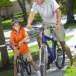 African American Man & Boy, Father and Son Riding Bikes — Stock Photo