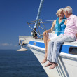 A happy senior couple sitting on the front of a sail boat — Stock Photo #21588711