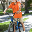 African American Boy Child Riding Bike — Stock Photo #21588831