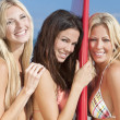 Three Beautiful Women Surfers In Bikinis With Surfboard At Beach — Stock Photo