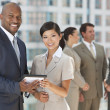 Interracial Men & Women Business Team With Tablet Computer — Foto Stock
