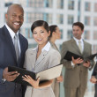 Interracial Men & Women City Business Team — Stock Photo #21589911