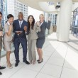 Interracial Men & Women Business Team With Tablet Computer - Stock Photo