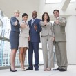 Interracial Men & Women Business Team Thumbs Up — Stock Photo
