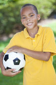 African American Boy Playing With Football or Soccer Ball — Stock Photo