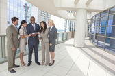 Interracial Men & Women Business Team With Tablet Computer — Stock Photo